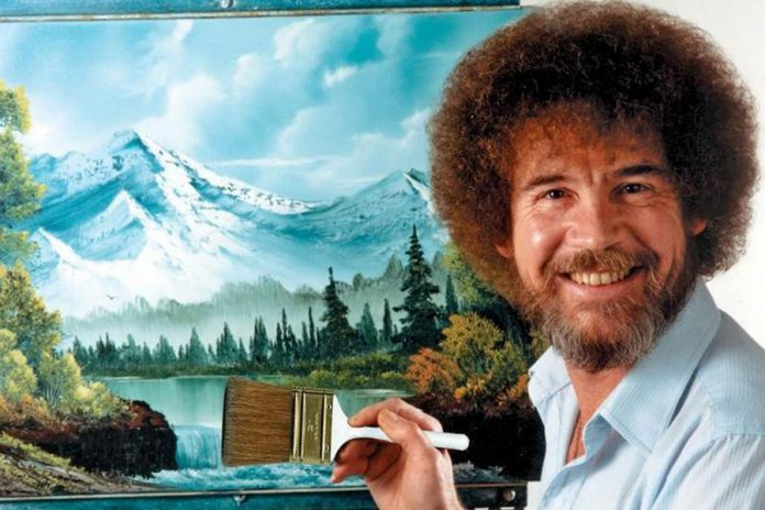 The late artist Bob Ross at his easel. Ross completed more than 1,000 landscape paintings during the 403-episode run of 'The Joy of Painting'. (Publicity photo / Bob Ross Inc.)