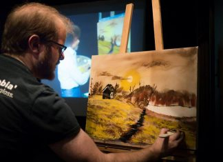 Andrew Root paints during 'The Joy of Bob' at The Theatre on King in downtown Peterborough in 2017. The event, where three guest painters are challenged before a live audience to follow an episode of 'The Joy of Painting', the instructional TV show hosted by late painter Bob Ross, returns on February 20, 2020. The guest painters will be Kathryn Bahun, garbageface, and a random audience member. (Photo courtesy of Andy Carroll)