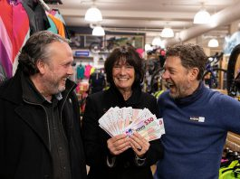 """Karen Procyk of Peterborough collects her grand prize of $1,500 in """"downtown money"""" at Wild Rock Outfitters on 169 Charlotte Street after her Holiday Shopping Passport was drawn at the culmination of the annual initiative by the Peterborough Downtown Business Improvement Area (DBIA) to encourage people to choose local. Also pictured is DBIA executive director Terry Guiel (left) and Wild Rock Outfitters co-owner Kieran Andrews. (Photo courtesy of Peterborough DBIA)"""