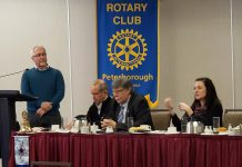 Peterborough Mayor Diane Therrien (right) spoke at the Rotary Club of Peterborough meeting at the Holiday Inn on January 27, 2020, along with Peterborough County Warden J. Murray Jones (second from right). Also pictured are Rotarians Jay Amer (at the podium) and Kevin Duguay. (Photo: Jeannine Taylor / kawarthaNOW.com)