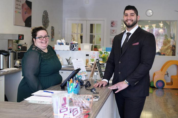 While Dabbah Corp works with both large and small companies, owner Waleed Dabbah (pictured here with client Sarah Susnar, owner and operator of family activity studio Play Cafe) says his company's services are especially beneficial to small businesses. (Photo: 705 Creative / kawarthaNOW)