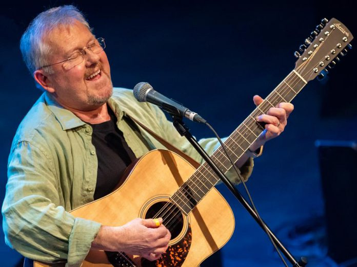 """Danny Bronson, pictured here performing the music of John Denver at Showplace Performance Centre in April 2019, will be hosting the United Way of Peterborough & District's first-ever """"streamathon"""" on Facebook. The live concert, which also features several other Peterborough-area musicians, begins at 8 p.m. on January 30, 2020. (Photo courtesy of Laszlo Prising Photography / laszloprisingphoto.com)"""