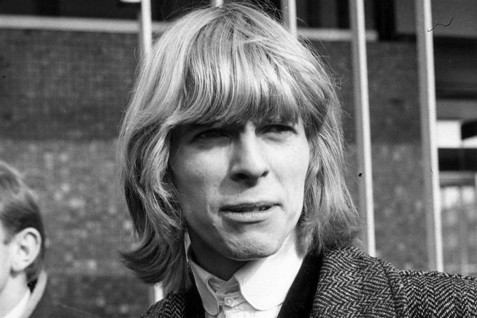 British singer-songwriter David Bowie at the beginning of his career in 1965, when he changed his stage name from Davy Jones to avoid confusion with the name of the lead singer of American rock band The Monkees. (Photo via Brian Eno / Twitter)