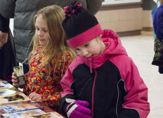"""Young readers check out the books on display at last year's annual Family Literacy Day in Peterborough Square. This year's Saturday morning event, with the theme """"Once Upon A Turtle"""", takes place on January 25, 2020 in the lower level of in Peterborough Square. It features children's author Andrew Larsen, Plugging Into Nature music and puppet show, a live turtle exhibit by Ontario Turtle Conservation Centre, Celebrity Readers' Theatre, and face painting. Admission is free and every child leaves with a free book. (Photo courtesy of Peter Rellinger)"""