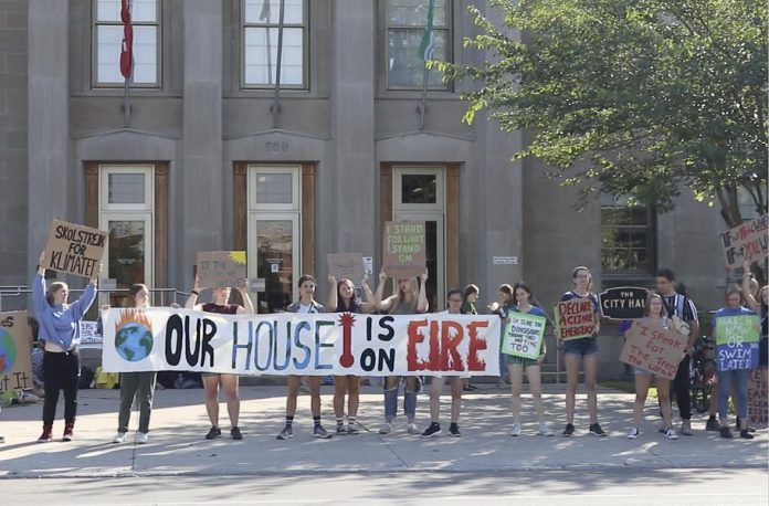 "Students gather for a climate change protest at Peterborough City Hall in a still from ""You(th)"". The short film by local high school student Nico Ossa opens the 16th annual ReFrame Film Festival at Showplace Performance Centre on Thursday, January 23rd, accompaning the award-winning feature-length Peruvian documentary ""Máxima"" that premiered at Hot Docs 2019. Both documentaries speak to the power of individuals to make change. (Photo courtesy of ReFrame)"