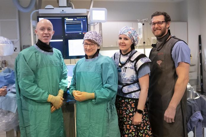 """Interventional Cardiologist Dr. Warren Ball (left) and members of the Cardiac Catheterization Lab team (Terri Matzke, Kate Graham, and Jeff Dunlop) at Peterborough Regional Health Centre (PRHC). The Leap 2 The Beat event on February 29, 2020 at Showplace Peformance Centre is raising funds for the PRHC Foundation's """"Keep your heart here"""" campaign to replace and upgrade life-saving equipment at PRHC's Cath Lab. (Photo courtesy of PRHC Foundation)"""
