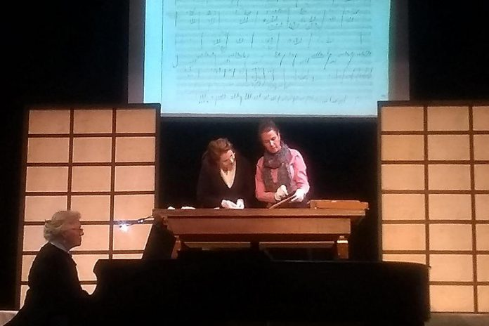 "In a scene from the Peterborough Theatre Guild's production of ""33 Variations"", Dr. Gertrude Landenburger (Gayle Fraser, right) explains Beethoven's compositional techniques to Dr. Katherine Brandt (Jane Werger, middle) as an image of Beethoven's actual work is projected on a screen behind them. Pianist Karen Locklin (left) performs Beethoven's Diabelli Variations throughout the play, making the music a character in its own right. (Photo: Sam Tweedle)"