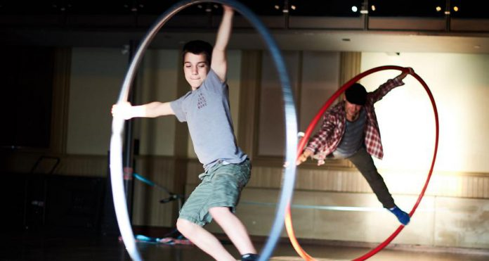 """Ethan performing on the cyr wheel in """"Circus Boy"""", a film about family dynamics by LA Alfonso. (Photo: LA Alfonso)"""