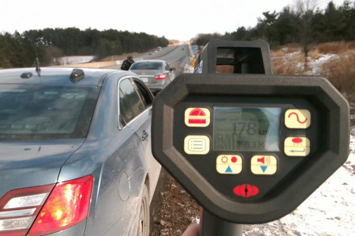 Police stop a motorist on Highway 401 in the Port Hope area who was driving at 178 km/h, one of five drivers charged by police with stunt driving in a six-hour period on January 8, 2020. (Supplied photo)