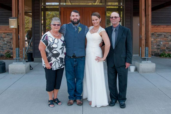 Wade Hartin and his wife Emily with Wade's parents Mary and Brad at the couple's wedding.  Wade was killed in an accident on January 14, 2020 while working working at his job as a snow grooming machine operator at Dagmar Ski Resort near Uxbridge. Emily is due to give birth to the couple's first child in April, and a GoFundMe campaign has been set up to support Emily and Baby Hartin.   (Photo supplied by Ashley Webster)