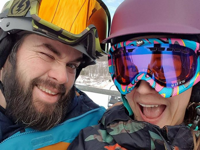 Wade Hartin and his wife Emily snowboarding. Wade was killed in an accident on January 14, 2020 while working working at his job as a snow grooming machine operator at Dagmar Ski Resort near Uxbridge. Emily is due to give birth to the couple's first child in April, and a GoFundMe campaign has been set up to support Emily and Baby Hartin.   (Photo supplied by Ashley Webster)