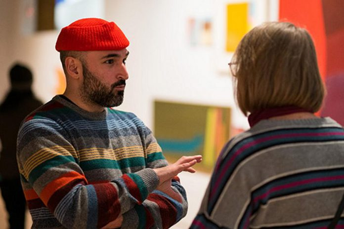 Francisco-Fernando Granados (left) in conversation with guest at the opening reception for 'duet' at the  Art Gallery of Peterborough on January 28, 2020. (Photo: Matthew Hayes)