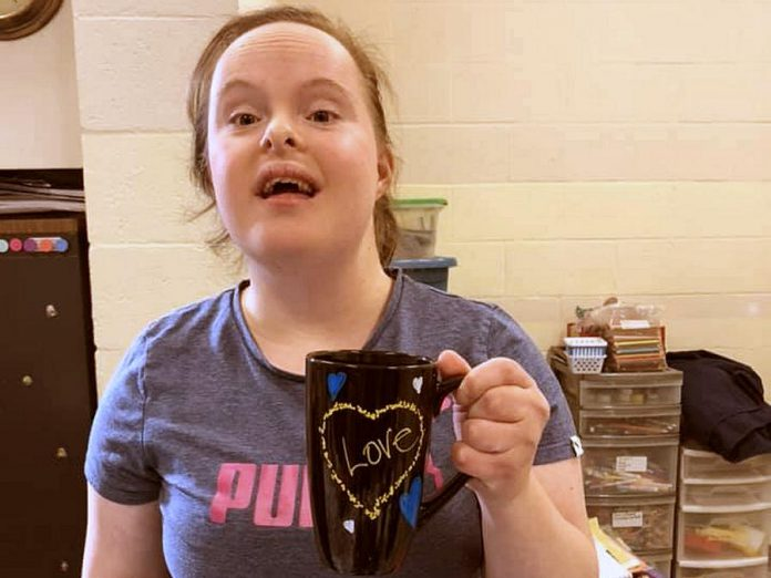 "The Biz Group's custom, hand-painted ""love mugs"" are available for $10 each, with all proceeds going to Biz Group members. (Photo courtesy of Down Syndrome Association of Peterborough)"