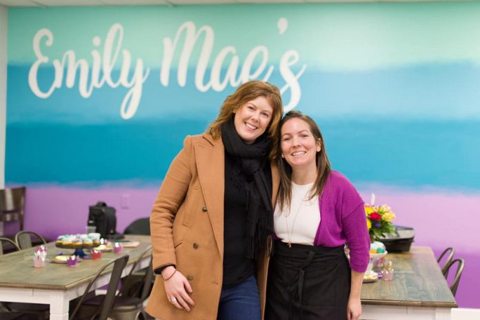 Emily Mae's Cookies & Sweets owner Jennifer Wight (right) with Madeleine Hurrell, entrepreneurship officer at Peterborough & the Kawarthas Economic Development's Business Advisory Centre. Hurrell oversees the Starter Company Plus program, which awarded Wight a $4,000 grant in 2017 to help build her business. Wight held the grand opening of her brick-and-mortar shop at 1135 Lansdowne Street West in Peterborough on February 1, 2020. (Photo: Peterborough & the Kawarthas Economic Development / Facebook)