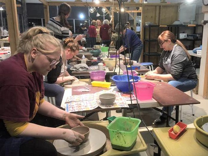 Members of the Kawartha Potters Guild came together in January to make more than 115 wheel-thrown and hand-built bowls for the annual YWCA Empty Bowls fundraiser. The Kawartha Woodturners Guild and Artisans Centre Peterborough have also donated hand-crafted bowls for the event, which takes place at 12 p.m. on February 28, 2020 at  The Venue in downtown Peterborough. (Photo:  Kawartha Potters Guild / Facebook)