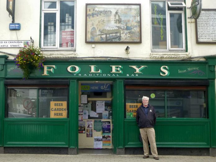 Storyteller Hugh Foley in front of a pub named Foley's in Ireland. During the fourth annual Foley's Irish Pub on March 15, 2020 in the Nexicom Studio at Showplace Performance Centre in downtown Peterborough, Foley will reprise his role as seanchaí (an Irish storyteller) by regaling the audience with tales of Ireland, with Irish music supplied by 4 Front and special guests Fiddlin' Jay Edmunds, Ron Kervin, Bridget Foley, Nancy Towns Trio, Catherine McInnis, Maria O'Grady, and Phil McCann. (Photo courtesy of Theresa Foley)