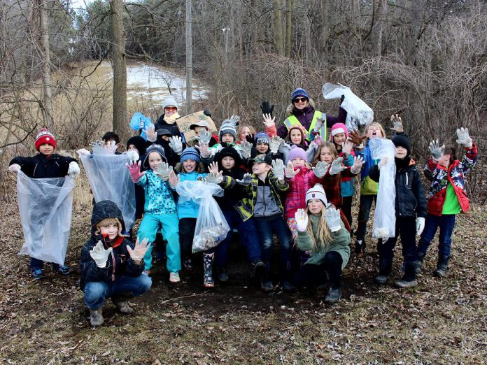 Rather than ignoring environmental problems in the hope someone else will fix them, you can take personal actions like cleaning up litter and reducing how much garbage you produce to help reduce your impact on the environment and climate change. In partnership with GreenUP's Sustainable Urban Neighbourhoods program, approximately 100 students and staff from King George Public School in Peterborough organized a clean-up of Armour Hill on April 5, 2018 in celebration of Earth Day.  (Photo courtesy of GreenUP)
