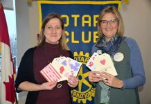 Hospice Peterborough executive director Hajni Hos and board president Shelley Barrie with some of the customized Valentine's Day cards that members of the Rotary Club of Peterborough Kawartha recently created for clients of the non-profit organization, which offers support to individuals and families living with or affected by life-threatening illness and grief. (Photo courtesy of Rotary Club of Peterborough Kawartha)