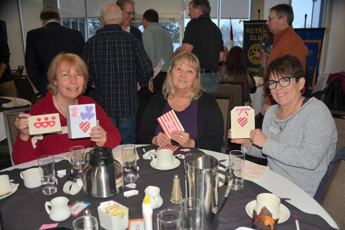 Liz Woosey, Brenda Booth, and Peggy Shaughnessey displaying a few of the customized Valentine's Day cards that Kawartha Rotarians recently created for Hospice Peterborough clients. (Photo courtesy of Rotary Club of Peterborough Kawartha)