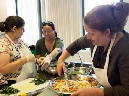 Chef Elaine McCarthy (right) coaches participants at the the Council for Persons with Disabilities' Active Together cooking class. The cooking classes, which are open to anyone over the age of 18 who self-identifies as living with a disability, run every Friday morning during the spring at Peterborough Public Health. (Photo: Council for Persons with Disabilities)