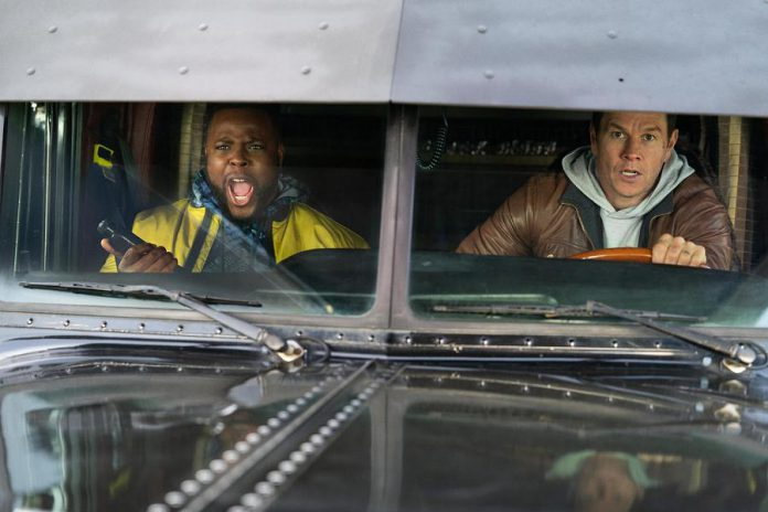 """Winston Duke and Mark Wahlberg team up to take down criminals in Boston in the action-comedy """"Spenser Confidential"""", premiering on Netflix on Friday, March 6th. (Photo: Netflix)"""