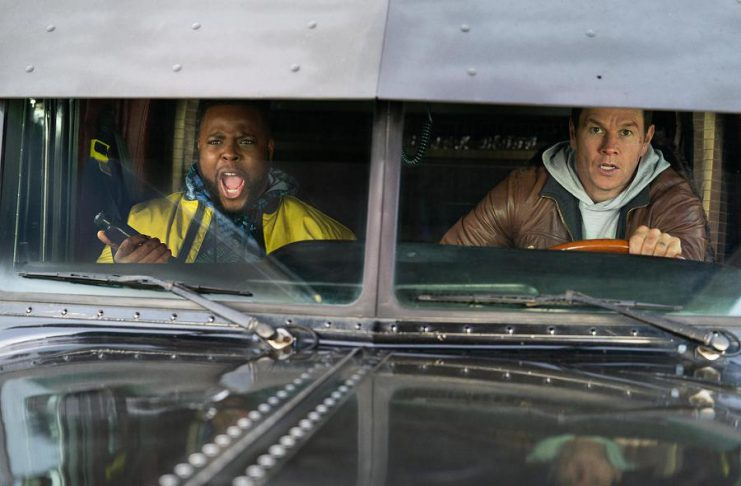 "Winston Duke and Mark Wahlberg team up to take down criminals in Boston in the action-comedy ""Spenser Confidential"", premiering on Netflix on Friday, March 6th. (Photo: Netflix)"