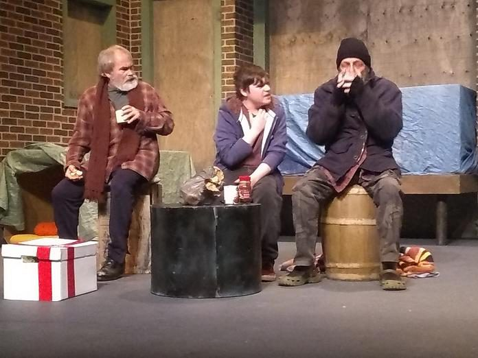 """Keith Goranson as Harry, Tyrnan O'Driscoll as Rainman, and Jack Roe as Harry in the Peterborough Theatre Guild production of """"Frozen Dreams"""", written and directed by Robert Ainsworth. The critically acclaimed play, often referred to as """"the play about the homeless people and the turkey"""", runs at the Guild Hall in Peterborough from February 21 to March 7, 2020. (Photo: Sam Tweedle / kawarthaNOW.com)"""