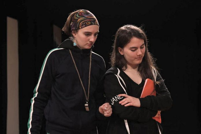 "In Amanda Murray Cutalo's one-act comedy ""Typecast"", gym-teacher-turned-drama-teacher Ms. Ball (Taite Cullen, left) casts normally typecast student actors, including Jane ""The Control Freak"" (Lena Ross, right), against type in a high school play. Presented by youth theatre group Enter Stage Right, the play runs for one night only at the Peterborough Collegiate auditorium on February 29, 2020. (Photo: Dakota Hamilton)"