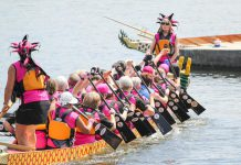 Paddlers at the 2015 Peterborough's Dragon Boat Festival, which returns to Del Crary Park in Peterborough for its 20th year on Saturday, June 13th. To date, the annual event has raised more than $3.6 million for for breast cancer screening, diagnosis, and treatment at Peterborough Regional Health Centre. (Photo: Linda McIlwain / kawarthaNOW.com)