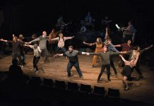 "The 15 members of the cast, all Trent University students, during a dress rehearsal of the musical song cycle ""The Theory of Relativity"", which runs for six performances from March 13 to March 26, 2020 at Market Hall Performing Arts Centre in downtown Peterborough. Musical director Justin Hiscox and his band, made up of Sam Quinn, Nick Gilroy, and Mark Hiscox, are pictured in the background. (Photo: Alyssa Cymbalista)"