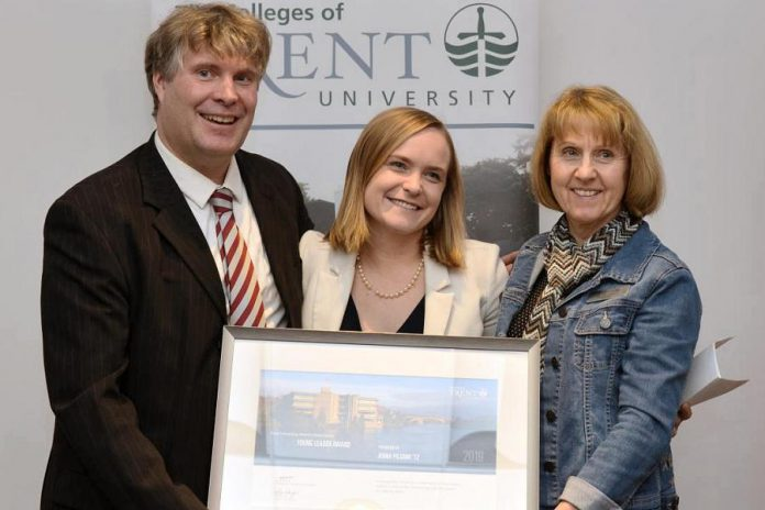 Jenna Pilgrim (centre), co-founder and CEO of blockchain start-up Streambed Media, receives the Young Alumni Leader Award from Trent University's Traill College principal Michael Eamon and Trent alumni engagement and services coordinator Sue Robinson in February 2020. Streambed Media was also mentioned in a recent Forbes story about the impact of blockchain technology on the media and entertainment industry. (Photo: Trent University)