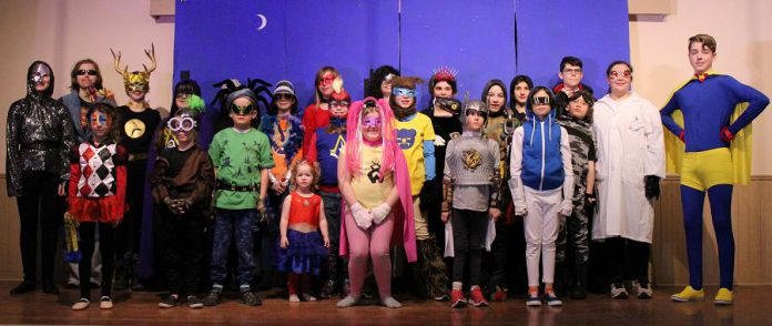 "The cast of Funfolk Theatricals' production of ""Calling All Sidekicks!"", written and directed by Cavan children's author Shan McFadden. In the family play, which runs from March 15 to 17, 2020 at the Millbrook Legion, the 24 young actors perform as superheroes, supervillains, and their sidekicks. (Photo: Siobhan MacQuarrie)"