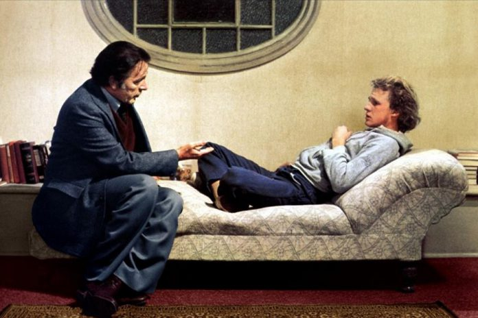 """In the 1977 film """"Equus"""" directed by Sidney Lumet and written by Peter Shaffer, based on his play of the same name, Richard Burton starred as Dr. Martin Dysart with Peter Firth reprising his role as Alan Strang from the original 1973 stage production. (Photo:  United Artists Corporation)"""