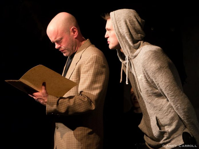 """In The Theatre on King's production of """"Equus"""", Dan Smith performs as psychiatrist Dr. Martin Dysart with Conner Clarkin as his disturbed young patient Alan Strang. (Photo: Andy Carroll)"""