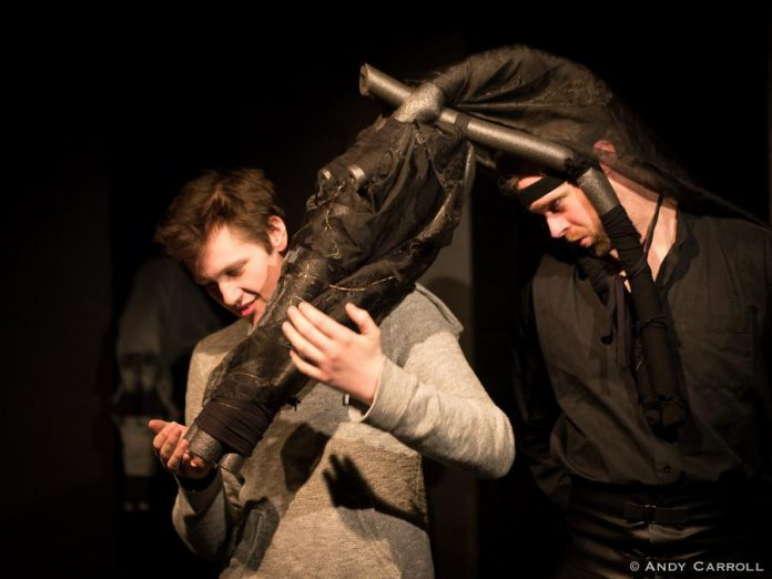 Conner Clarkin as Alan Strang with Derek Bell as Nugget, a horse with which Alan as an erotic fixation. The horse heads were designed by Ann Jaeger with set and costumes by Kate Story. (Photo: Andy Carroll)