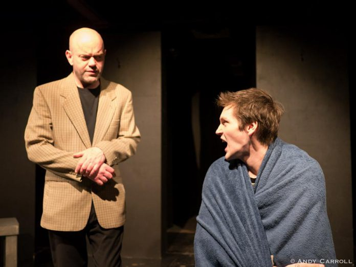 """'Equus"""" is based on the true story of a 17-year-old boy who blinded six horses in Suffolk, England. In The Theatre on King production, psychiatrist Dr. Martin Dysart (Dan Smith) attempts to treat Alan Strang (Conner Clarkin), who has a pathological religious fascination with horses. (Photo: Andy Carroll)"""