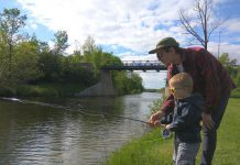GreenUP's Matthew Walmsley enjoys some quality family time as he teaches his son how to fly fish along the Trent-Severn Waterway in Peterborough. By practising sustainable recreational fishing, children and adults alike can enjoy physical and psychological health benefits of spending time in the natural environment. (Photo courtesy of Matthew Walmsley)