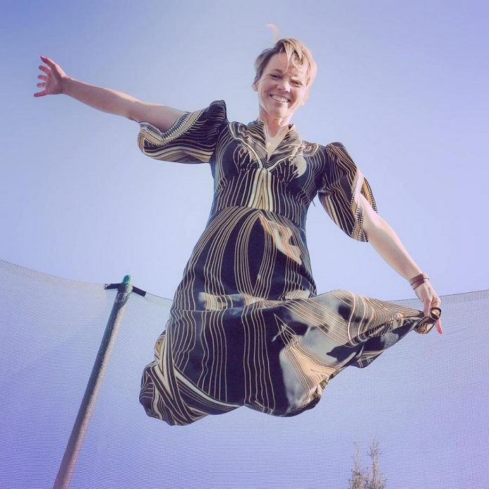 Port Hope artist Lee Higginson celebrating her birthday on March 27, 2020 by bouncing on a trampoline while wearing a designer gown that someone anonymously gifted her last year -- which is another story. (Photo courtesy of Lee Higginson)