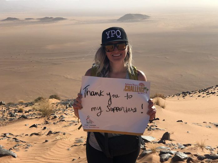 Linz Hunt of Royal LePage Frank Real Estate in Peterborough in the Sahara Desert in November 2019, when she trekked 100 kilometres along with 120 Royal LePage professionals to raise funds for women's shelters and and domestic violence prevention and education programs across Canada. Hunt raised $17,820 in support of YWCA Crossroads Shelter. (Supplied photo)