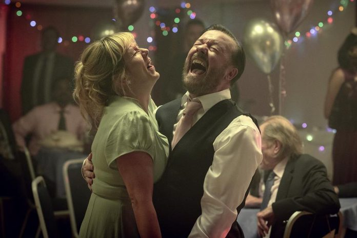 "Ricky Gervais returns for the second season of the acclaimed dark comedy ""After Life"", which premieres on Netflix Canada on Friday, April 24th. In the second season, small-town journalist Tony Johnson (Gervais) still struggles with grief over the loss of his wife Lisa (Kerry Godliman) to cancer, while he tries to become a better friend to those around him. Will the town of Tambury's local amateur theatre production life everyone's spirits? (Photo: Netflix)"