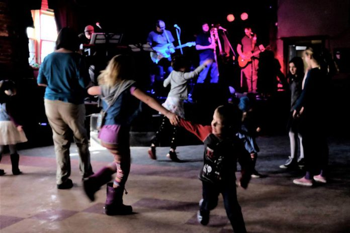 Peterborough reggae and ska band Dub Trinity are performing their annual tribute to Bob Marley this weekend at the Historic Red Dog in downtown Peterborough, with an evening show on Friday, March 6th followed by an all-ages matinee show at 2 p.m. on Saturday, March 7th when kids get in free. Pictured are kids dancing at the 2018 all-ages matinee show. (Photo: Selrahc Yrogerg via dubtrinity.com)
