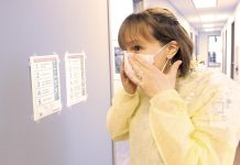 Public health nurse Julie Brandsma dons a mask as she prepares to test a patient for COVID-19. (Photo courtesy of Peterborough Public Health)