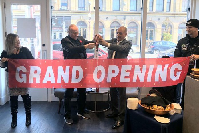 United Way campaign chair David Goyette and TVM Group president and CEO Amit Sofer cut the ribbon at the grand opening of the East City Condos showroom on October 26, 2019. TVM Group has donated $1,500 to United Way of Peterborough & District. (Supplied photo)