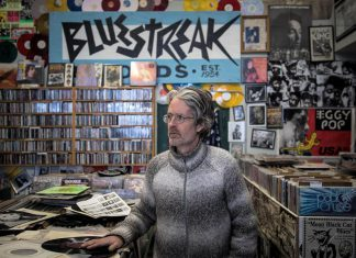 """Tim Haines is the owner of Bluestreak Records, one of 80 downtown Peterborough businesses from which you can buy gift certificates online at supportdowntownptbo.ca. The Peterborough Downtown Business Improvement Area (DBIA) is bringing back its popular """"spend $50 and get $25 in downtown money"""", while quantities last, when you purchase gift certificates from the website. (Photo courtesy of DBIA)"""
