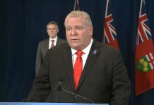 Ontario Premier Doug Ford, with Minister of Finance Rod Phillips behind him, announcing the new Ontario-Canada Emergency Commercial Rent Assistance Program on April 24, 2020. (Screenshot / YouTube)