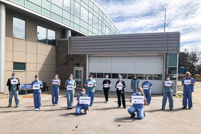 "The emergency dapartment team at Ross Memorial Hospital in Lindsay with a message for the community: ""We are here for you, please stay home for us."" (Photo courtesy of Ross Memorial Hospital)"
