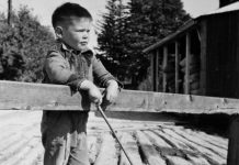 Five-year-old Neil Young in August 1950, fishing from a wooden bridge over the Pigeon River in Omemee. In August 1951, Young contracted polio and almost lost his life. (Photo: Harold Whyte)