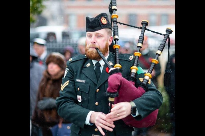 Master Corporal Maury McCrillis playing the lament at the Peterborough cenotaph at a Remembrance Day ceremony. (Photo: Hastings & Prince Edward Regiment Pipe Band / Facebook)