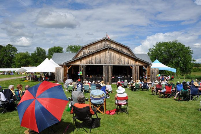 Westben's popular Concerts at The Barn series in Campbellford takes place in a 400-seat timber-frame barn with seating space for around one hundred people on lawn chairs in the meadow. (Photo: Westben)