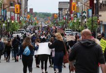 Hundreds of people, wearing masks and walking in small groups due to the COVID-19 pandemic, marched from Millennium Park to Confederation Square in downtown Peterborough on June 2, 2020 during a peaceful protest calling for an end to police violence against black and indigenous people of colour. (Photo courtesy of Sean Bruce)